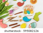 tulips and gingerbread cookies... | Shutterstock . vector #595082126