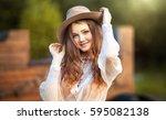 young beautiful girl in a... | Shutterstock . vector #595082138