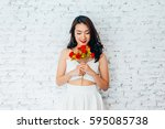 young happy asian woman smiling ... | Shutterstock . vector #595085738