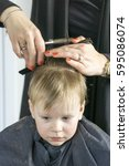 male child at the barber shop... | Shutterstock . vector #595086074