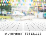 empty wooden table with party... | Shutterstock . vector #595131113