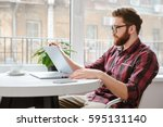 picture of concentrated bearded ... | Shutterstock . vector #595131140