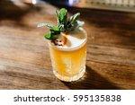 orange cocktail on bar table | Shutterstock . vector #595135838