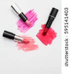 three lipsticks with swatches... | Shutterstock . vector #595141403