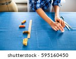 close up. hands woman tailor... | Shutterstock . vector #595160450
