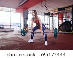 woman doing dead lifting in  gym | Shutterstock . vector #595172444