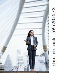 asian business woman walking on ... | Shutterstock . vector #595205573