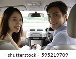 couple driving in car  looking... | Shutterstock . vector #595219709