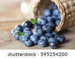 blueberry on wooden table | Shutterstock . vector #595254200