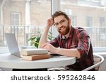 image of happy bearded young... | Shutterstock . vector #595262846