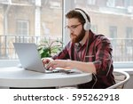 image of concentrated bearded... | Shutterstock . vector #595262918