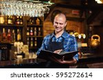 portrait of cheerful barman... | Shutterstock . vector #595272614