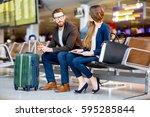elegant business couple sitting ... | Shutterstock . vector #595285844