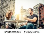 couple dating in a coffeehouse... | Shutterstock . vector #595293848
