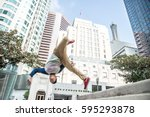 parkour man doing tricks on the ... | Shutterstock . vector #595293878