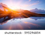mountain lake in the spring.... | Shutterstock . vector #595296854