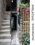 Small photo of SARTENE, CORSICA, FRANCE, SEPTEMBER 03, 2016: Very narrow alleyway next to the staircase