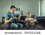 father teaching his son to play ... | Shutterstock . vector #595321268