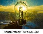 electrical light bulb in hand... | Shutterstock . vector #595338230