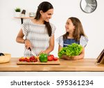 shot of a mother and daughter... | Shutterstock . vector #595361234