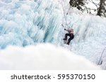 ice climbing on the waterfall | Shutterstock . vector #595370150
