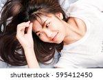 young asian women lying on...   Shutterstock . vector #595412450