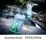 backpacking sitting on rocks by ... | Shutterstock . vector #595414946