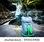 backpacking sitting on rocks by ... | Shutterstock . vector #595415900