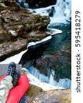 hiker on a sleeping bag in... | Shutterstock . vector #595418279