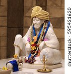 Small photo of SUNNYVALE, CA- USA APRIL 2016 - Hindu god Shirdi Sai Baba idol in Hindu temple. Sai Baba was an Indian spiritual master who was and is regarded by his devotees as a saint, fakir, and sat guru.