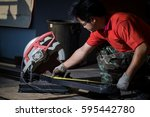 worker cuts a metal pipe by... | Shutterstock . vector #595442780