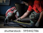 worker cuts a metal pipe by... | Shutterstock . vector #595442786
