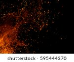 fire flames with sparks on a... | Shutterstock . vector #595444370