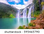 jiulong waterfall in luoping ... | Shutterstock . vector #595465790