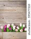 Colorful Tulips Over Wooden...
