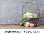easter eggs in basket on shelf... | Shutterstock . vector #595477370