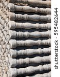 Small photo of an accurate pile of new cement pillars