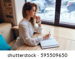 young blond girl making notes... | Shutterstock . vector #595509650