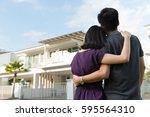 couple standing in front of... | Shutterstock . vector #595564310
