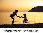 mother and daughter having fun... | Shutterstock . vector #595580234