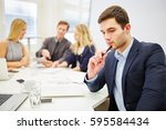 young businessman looking... | Shutterstock . vector #595584434