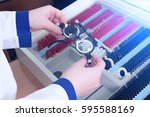 close up of optometrist holding ... | Shutterstock . vector #595588169