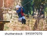 happy school girl enjoying... | Shutterstock . vector #595597070