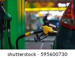car refueling on a petrol... | Shutterstock . vector #595600730
