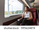 woman relaxing enjoying view... | Shutterstock . vector #595624874
