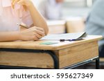 students writing test exam on... | Shutterstock . vector #595627349