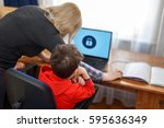 mother locking on computer for... | Shutterstock . vector #595636349