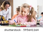 female teacher and elementary... | Shutterstock . vector #595641164