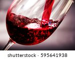 glass of full bodied red wine... | Shutterstock . vector #595641938