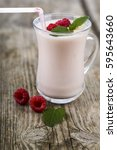 smoothies or yogurt with fresh... | Shutterstock . vector #595643660